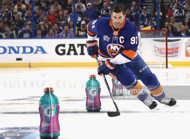 John Tavares of the New York Islanders competes in the Gatorade NHL Puck Control Relay during 2018 GEICO NHL AllStar Skills Competition at Amalie...