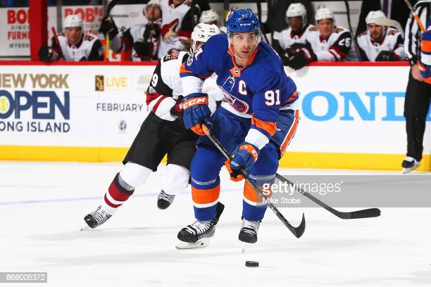 John Tavares of the New York Islanders controls the puck against the Arizona Coyotes at Barclays Center on October 24 2017 in New York City
