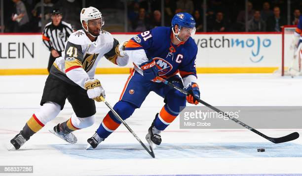 John Tavares of the New York Islanders controls the puck amid pressure from PierreEdouard Bellemare of the Vegas Golden Knights at Barclays Center on...