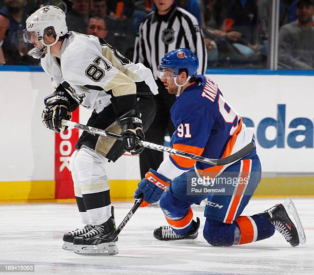 John Tavares of the New York Islanders covers Sidney Crosby of the Pittsburgh Penguins in Game Six of the Eastern Conference Quarterfinals during the...