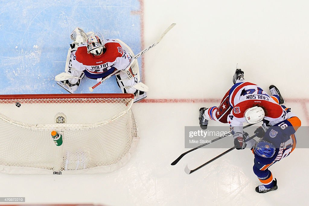 John Tavares #91 of the New York Islanders fires the puck past Braden Holtby #70 of the Washington Capitals for the game winning overtime goal during Game Three of the Eastern Conference Quarterfinals during the 2015 NHL Stanley Cup Playoffs at Nassau Veterans Memorial Coliseum on April 19, 2015 in Uniondale, New York. The Islanders defeated the Capitals 2-1 in overtime.