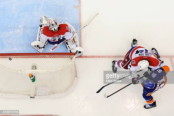 John Tavares of the New York Islanders fires the puck past Braden Holtby of the Washington Capitals for the game winning overtime goal during Game...