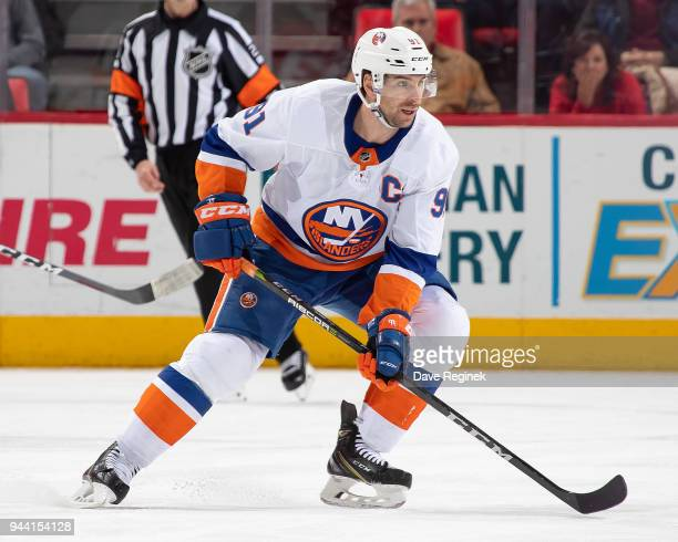 John Tavares of the New York Islanders follows the play against the Detroit Red Wings during an NHL game at Little Caesars Arena on April 7 2018 in...