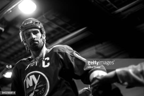 John Tavares of the New York Islanders high fives a fan on his way to warmup prior to the game against Toronto Maple Leafs at Barclays Center on...