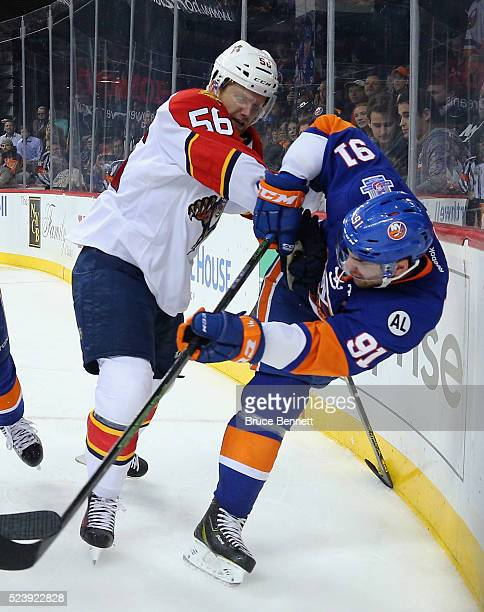 John Tavares of the New York Islanders is checked by Michael Matheson of the Florida Panthersin Game Six of the Eastern Conference First Round during...