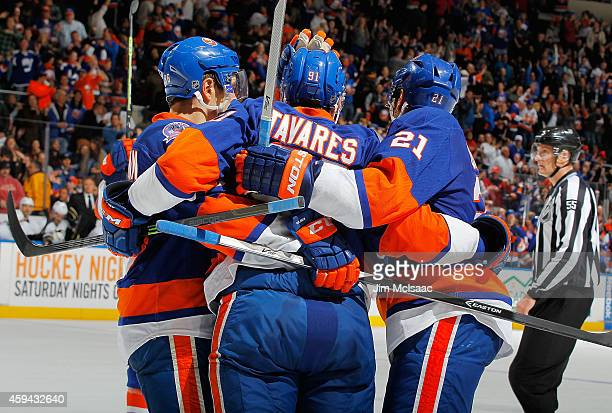 John Tavares of the New York Islanders is mobbed by teammates congratulating him on his third period goal during the game against the Pittsburgh...