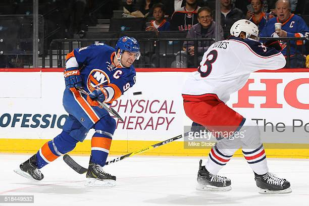 John Tavares of the New York Islanders plays the puck against Seth Jones of the Columbus Blue Jackets at the Barclays Center on March 31 2016 in...