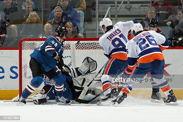 John Tavares of the New York Islanders puts in the game winning goal over goaltender Craig Anderson of the Colorado Avalanche as Matt Hunwick and...