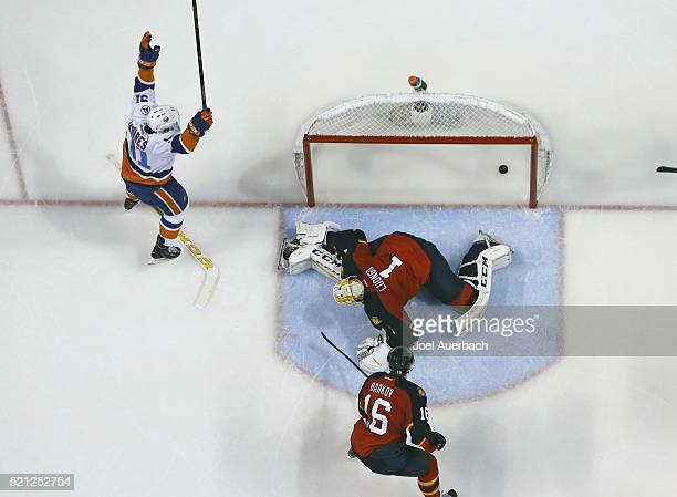 John Tavares of the New York Islanders raises his stick after scoring a second period goal past Goaltender Roberto Luongo of the Florida Panthers in...