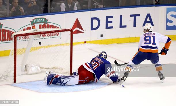 John Tavares of the New York Islanders scores a goal against Henrik Lundqvist of the New York Rangers in the overtime shoot out during their game at...