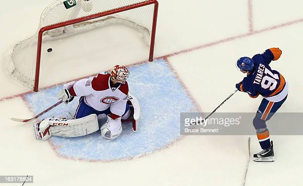 John Tavares of the New York Islanders scores a third period goal against Carey Price of the Montreal Canadiens at the Nassau Veterans Memorial...
