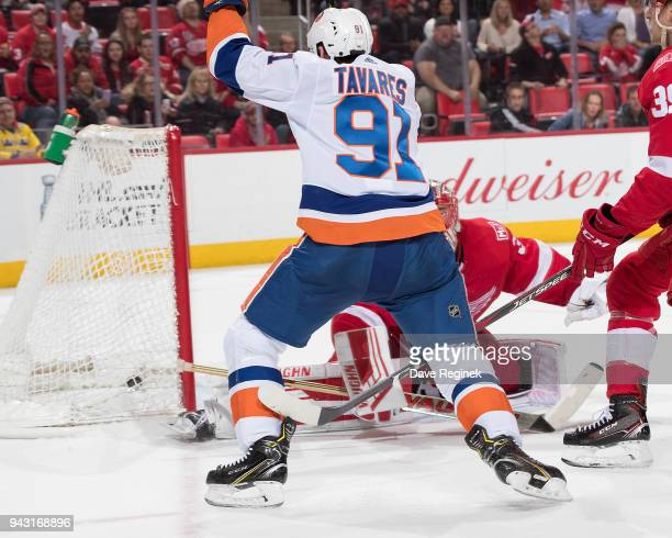 John Tavares of the New York Islanders scores an overtime goal past Jared Coreau of the Detroit Red Wings during an NHL game at Little Caesars Arena...