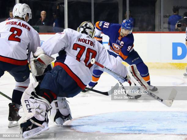 John Tavares of the New York Islanders scores at 134 of the second period against Braden Holtby of the Washington Capitals at the Barclays Center on...