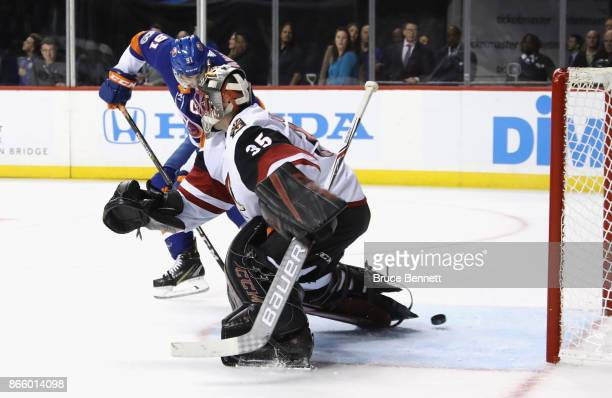 John Tavares of the New York Islanders scores at 1425 of the second period against Louis Domingue of the Arizona Coyotes at the Barclays Center on...
