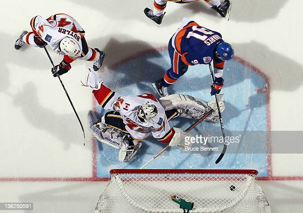 John Tavares of the New York Islanders scores the game winning goal at 320 of the third period against Miikka Kiprusoff of the Calgary Flames at the...