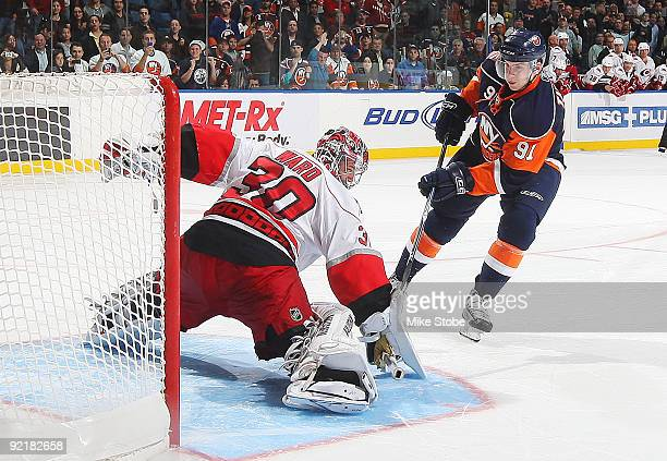 John Tavares of the New York Islanders scores the game winning goal in the shootout against Cam Ward of the Carolina Hurricanes on October 21 2009 at...