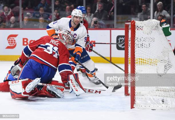 John Tavares of the New York Islanders scores the winning goal against the Montreal Canadiens in the NHL game at the Bell Centre on January 15 2018...