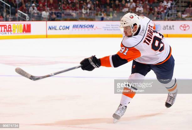 John Tavares of the New York Islanders shoots the puck during the NHL game against the Phoenix Coyotes at Jobingcom Arena on January 9 2010 in...