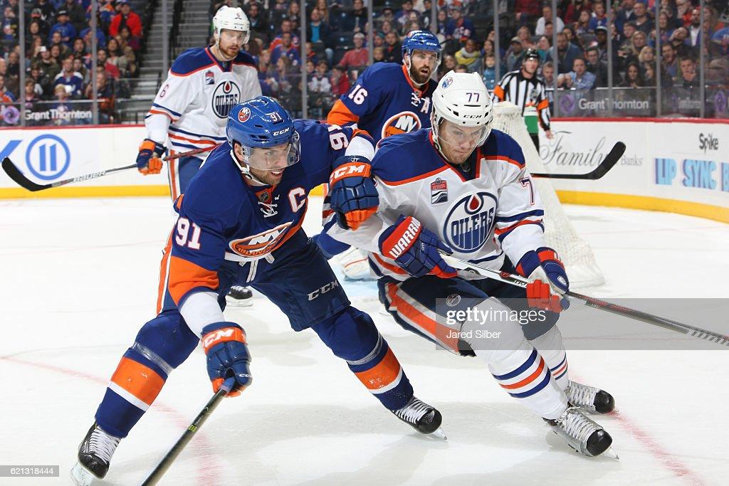 John Tavares #91 of the New York Islanders skates against Oscar Klefbom #77 of the Edmonton Oilers at the Barclays Center on November 5, 2016 in Brooklyn borough of New York City.