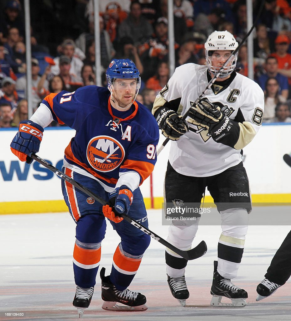John Tavares #91 of the New York Islanders skates against Sidney Crosby #87 of the Pittsburgh Penguins in Game Three of the Eastern Conference Quarterfinals during the 2013 NHL Stanley Cup Playoffs at the Nassau Veterans Memorial Coliseum on May 5, 2013 in Uniondale, New York.
