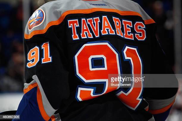 John Tavares of the New York Islanders skates against the Carolina Hurricanes at the Nassau Veterans Memorial Coliseum on January 4 2014 in Uniondale...