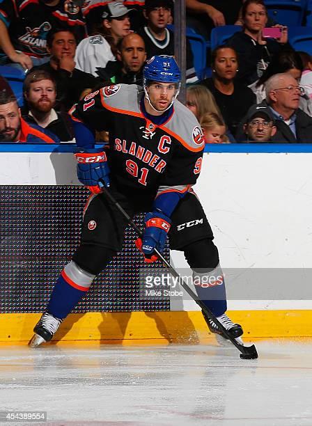 John Tavares of the New York Islanders skates against the Dallas Stars at Nassau Veterans Memorial Coliseum on December 21, 2013 in Uniondale, New...
