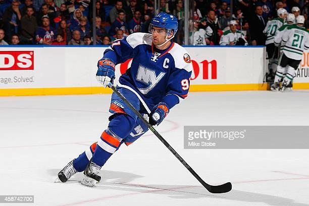 John Tavares of the New York Islanders skates against the Dallas Stars at Nassau Veterans Memorial Coliseum on October 25, 2014 in Uniondale, New...