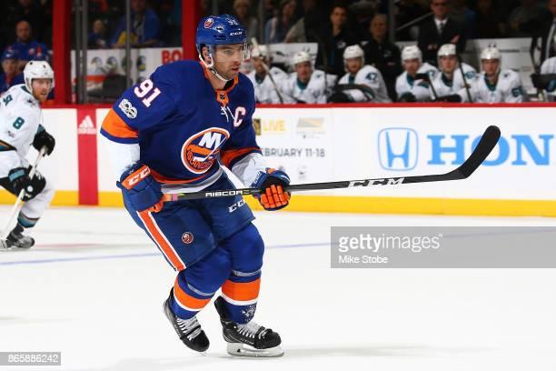 John Tavares of the New York Islanders skates against the San Jose Sharks at Barclays Center on October 21 2017 in New York City