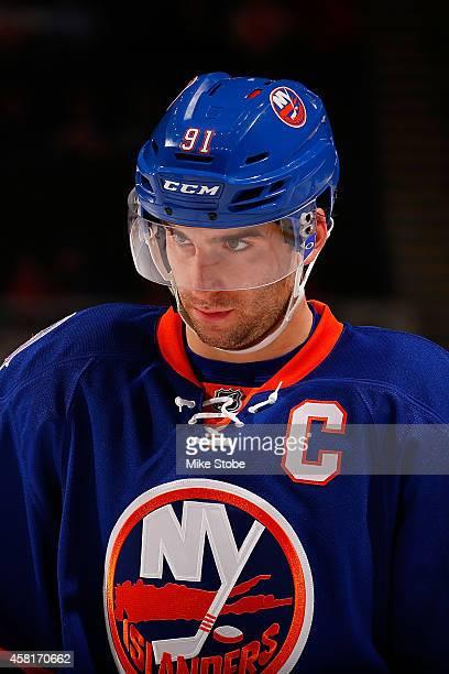 John Tavares of the New York Islanders skates against the Toronto Maple Leafs at Nassau Veterans Memorial Coliseum on October 21, 2014 in Uniondale,...