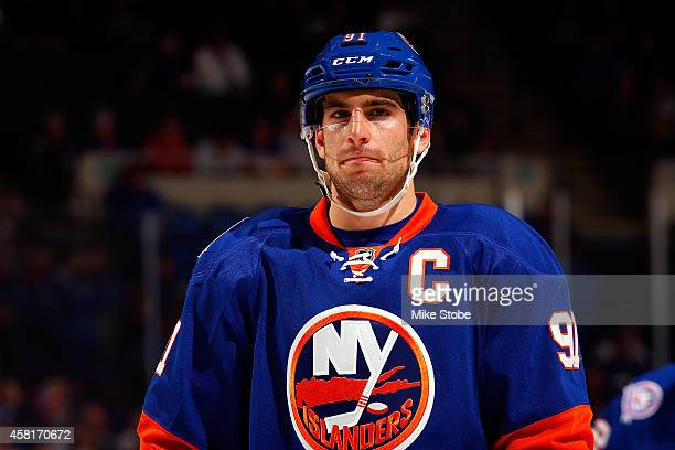 John Tavares of the New York Islanders skates against the Toronto Maple Leafs at Nassau Veterans Memorial Coliseum on October 21 2014 in Uniondale...