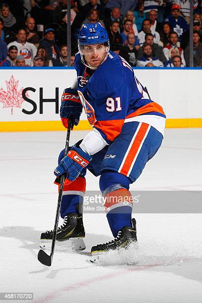 John Tavares of the New York Islanders skates against the Toronto Maple Leafs at Nassau Veterans Memorial Coliseum on October 21 2014 in Uniondale...
