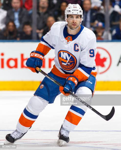 John Tavares of the New York Islanders skates against the Toronto Maple Leafs during the third period at the Air Canada Centre on February 22 2018 in...