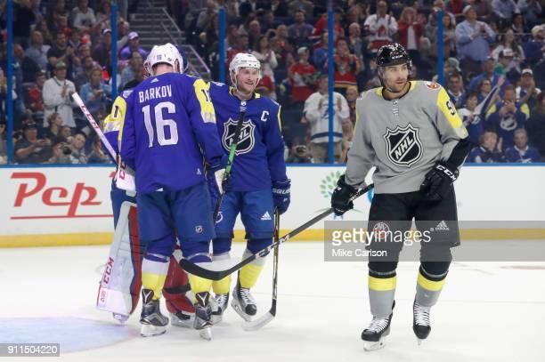 John Tavares of the New York Islanders skates by members of the Atlantic Division AllStars team in the second half during the 2018 Honda NHL AllStar...