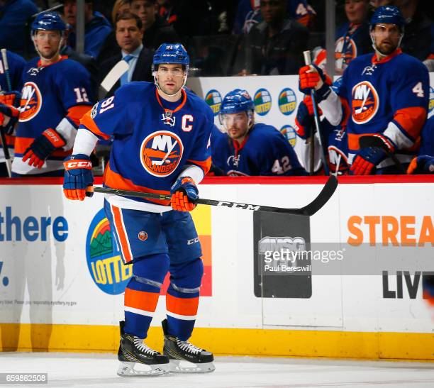 John Tavares of the New York Islanders skates during an NHL hockey game against the Boston Bruins at the Barclays Center on March 25 2017 in the...