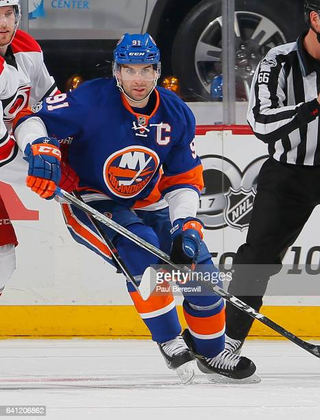 John Tavares of the New York Islanders skates in an NHL hockey game against the Carolina Hurricanes at Barclays Center on February 4 2017 in the...