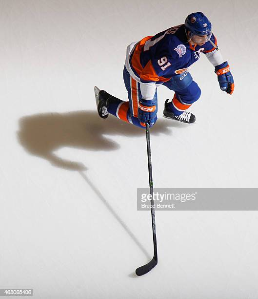 John Tavares of the New York Islanders skates in warmups prior to the game against the Detroit Red Wings at the Nassau Veterans Memorial Coliseum on...