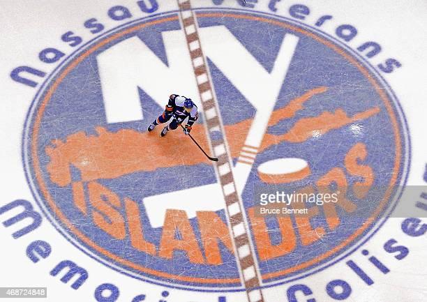 John Tavares of the New York Islanders skates over the Islander logo during the game against the Buffalo Sabres at the Nassau Veterans Memorial...