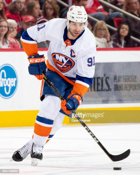 John Tavares of the New York Islanders skates up ice with the puck against the Detroit Red Wings during an NHL game at Little Caesars Arena on April...