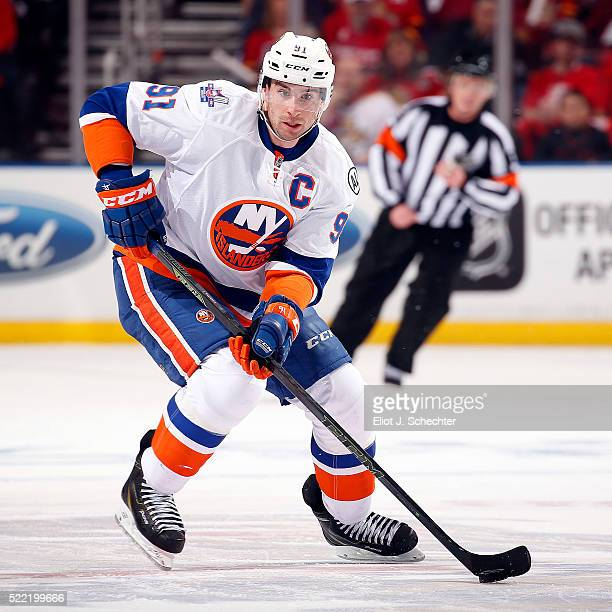 John Tavares of the New York Islanders skates with the puck against the Florida Panthers in Game One of the Eastern Conference Quarterfinals during...