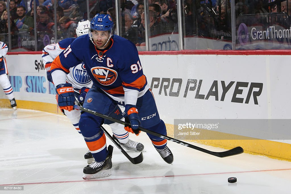 John Tavares #91 of the New York Islanders skates with the puck against the Edmonton Oilers at the Barclays Center on November 5, 2016 in Brooklyn borough of New York City.
