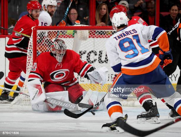 John Tavares of the New York Islanders takes a shot on goal as Cam Ward deflects the puck away from the crease during an NHL game on November 19 2017...