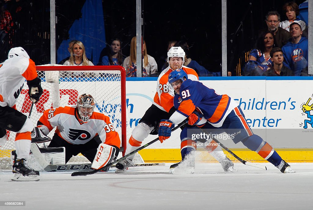 John Tavares #91 of the New York Islanders takes the shot against Steve Mason #35 of the Philadelphia Flyers at the Nassau Veterans Memorial Coliseum on November 24, 2014 in Uniondale, New York. The Islanders defeated the Flyers 1-0 in the shootout.