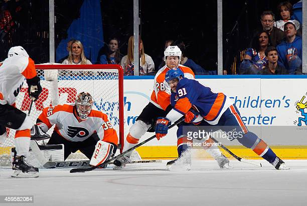 John Tavares of the New York Islanders takes the shot against Steve Mason of the Philadelphia Flyers at the Nassau Veterans Memorial Coliseum on...