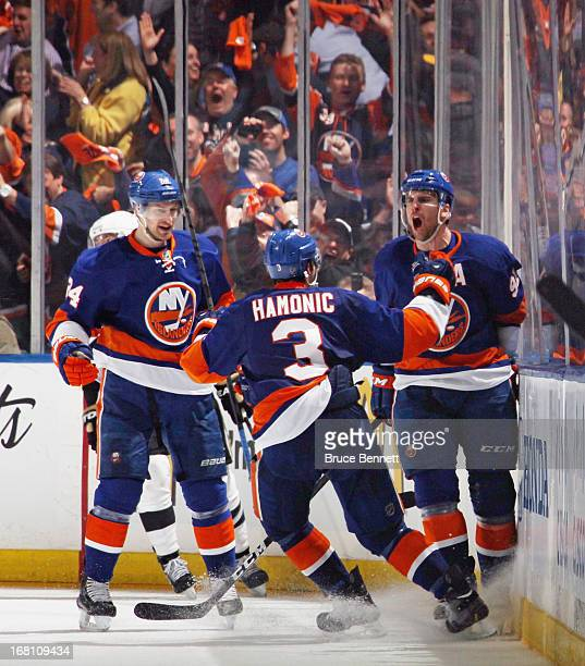 John Tavares of the New York Islanders ties the score at 44 against the Pittsburgh Penguins at 1048 of the third period and is joined by Brad Boyes...