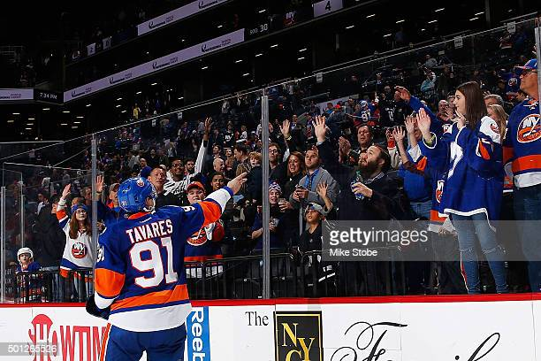 John Tavares of the New York Islanders tosses a puck to fans after the game against the New Jersey Devils at the Barclays Center on December 13 2015...