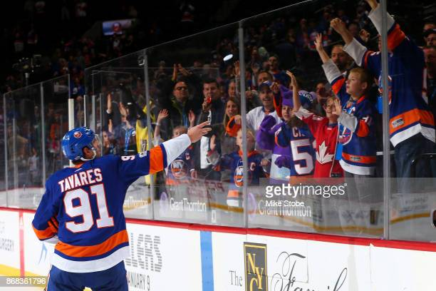John Tavares of the New York Islanders tosses a puck to fans after scoring two goals in a 63 win against the Vegas Golden Knights at Barclays Center...
