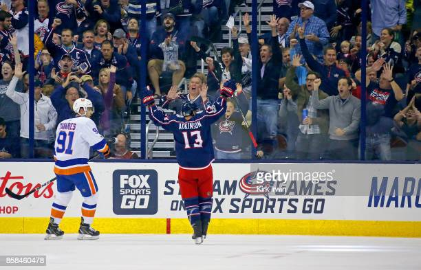 John Tavares of the New York Islanders watches as Cam Atkinson of the Columbus Blue Jackets celebrates after scoring a goal during the first period...