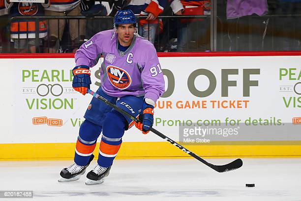John Tavares of the New York Islanders wears a lavender jersey during warmups for the annual Hockey Fights Cancer Awareness Night prior to the game...