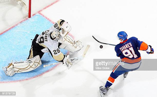 John Tavares of the the New York Islanders takes a shot on Marc-Andre Fleury of the Pittsburgh Penguins on October 3, 2009 at Nassau Coliseum in...