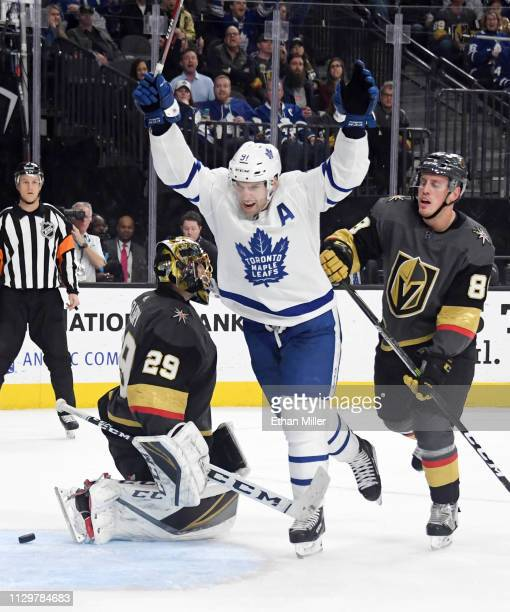 John Tavares of the Toronto Maple Leafs celebrates between MarcAndre Fleury and Nate Schmidt of the Vegas Golden Knights after Morgan Rielly of the...